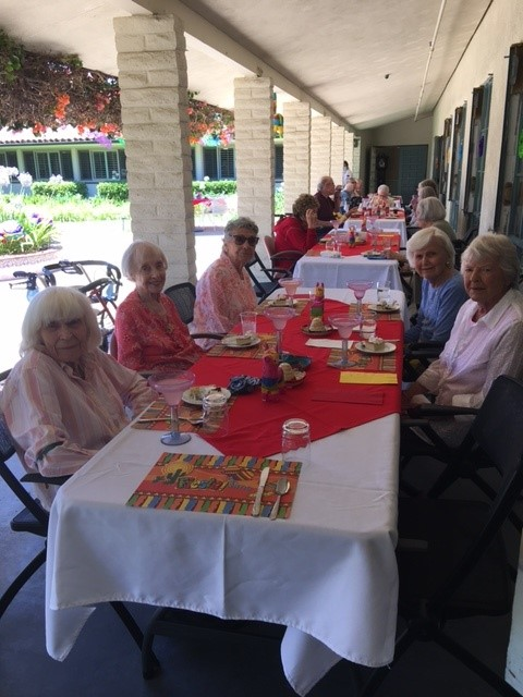 Wood Glen Hall residents enjoying the Fiesta lunch on the patio
