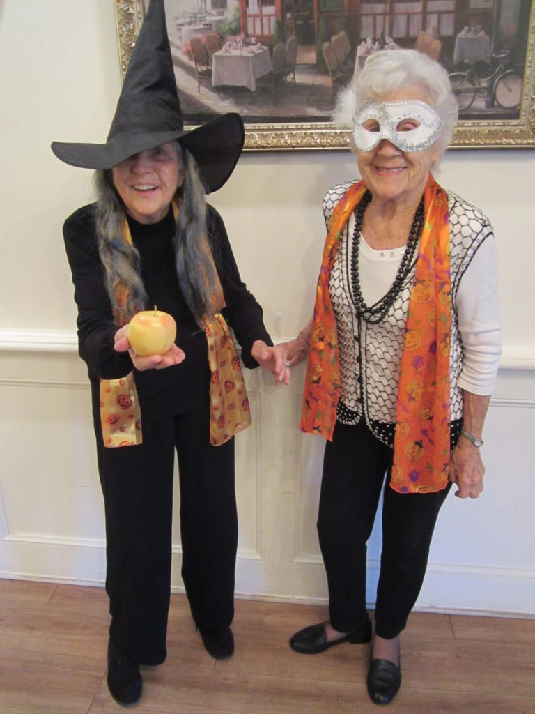 Two ladies dressed up for Halloween
