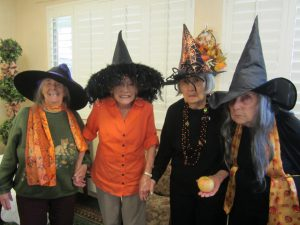 Four ladies dressed up as witches for Halloween