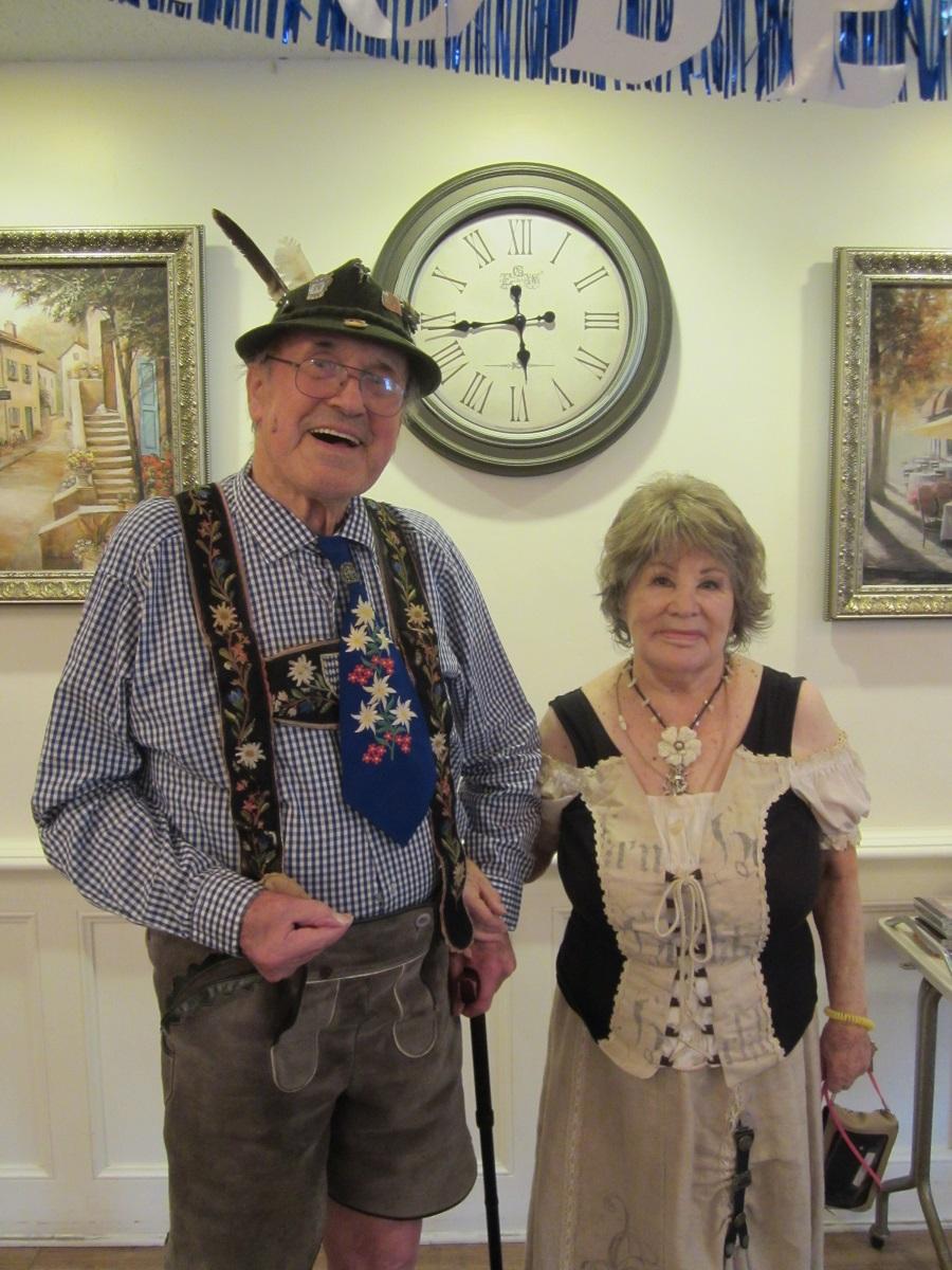 Two residents dressed festively for our Wood Glen Hall Assisted Living Oktoberfest Dinner