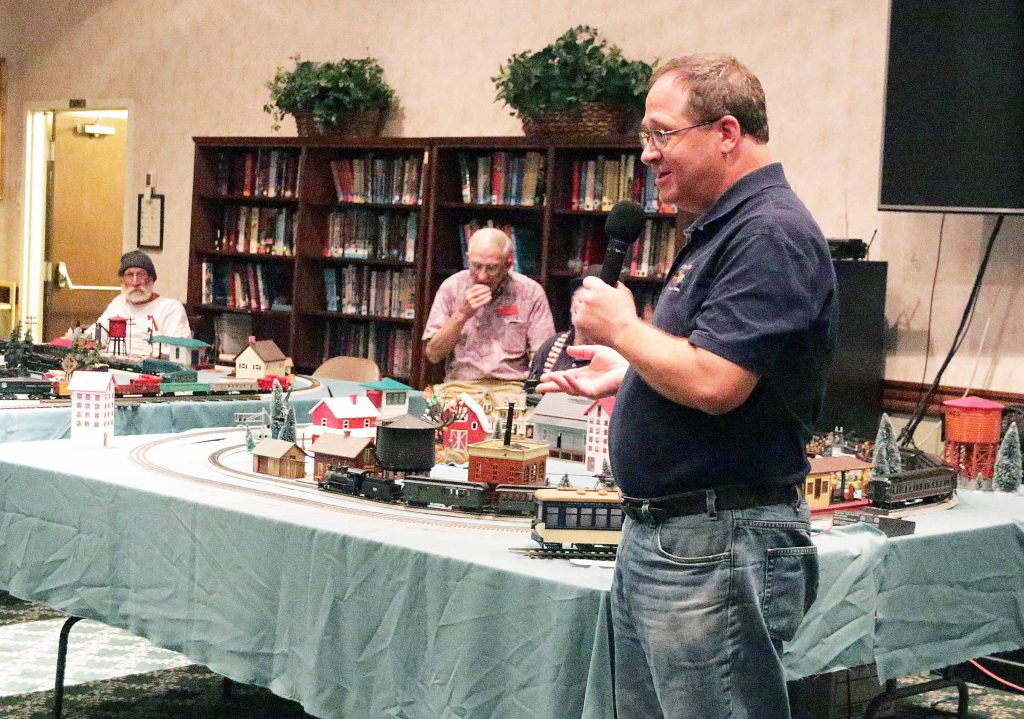 President of Toy Train Club speaks to the senior citizen residents at Wood Glen Hall