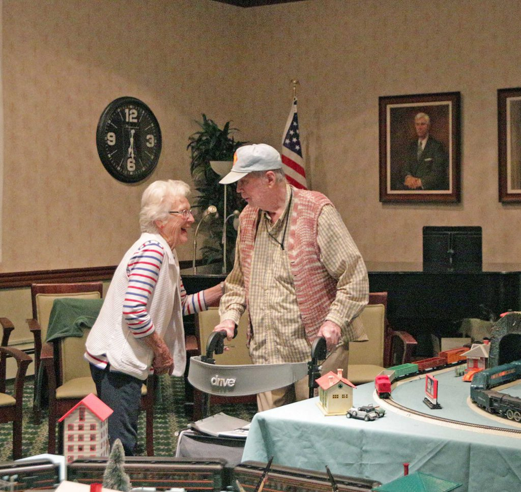 Two senior citizen residents of Wood Glen Hall Independent and Assisted Living Enjoy a Laugh Together