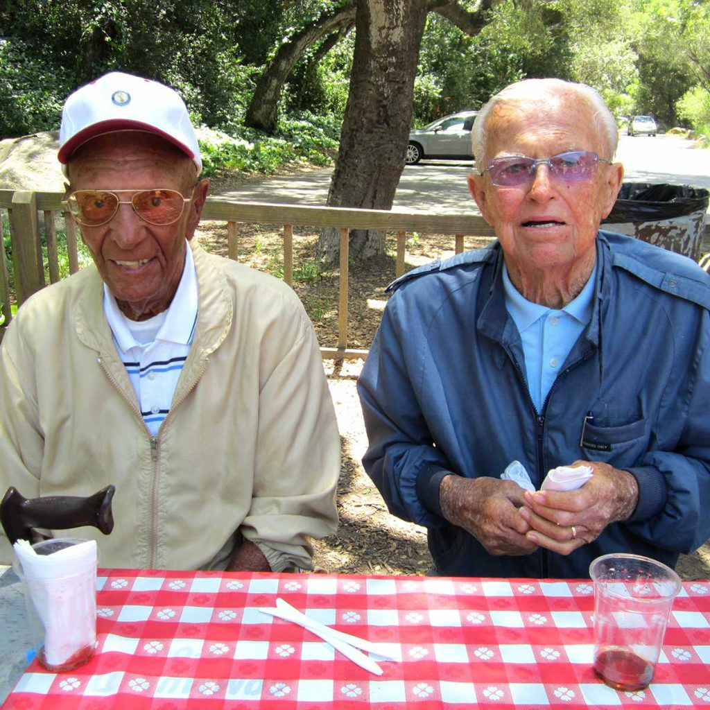 Two senior men enjoying An afternoon picnic at Steven's Park in Santa Barbara