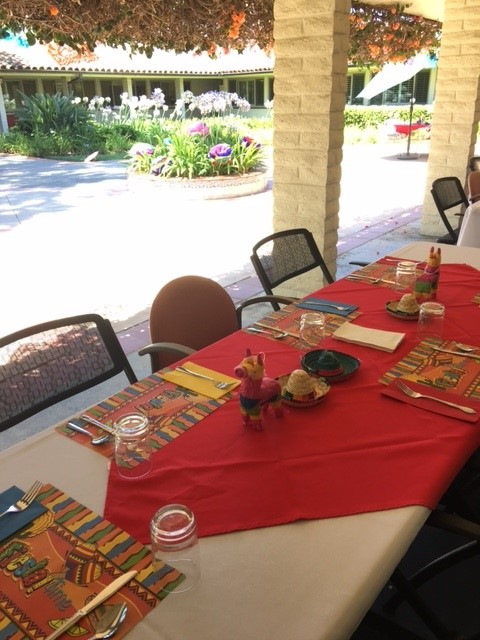 tables set for Fiesta lunch on the patio, garden backdrop