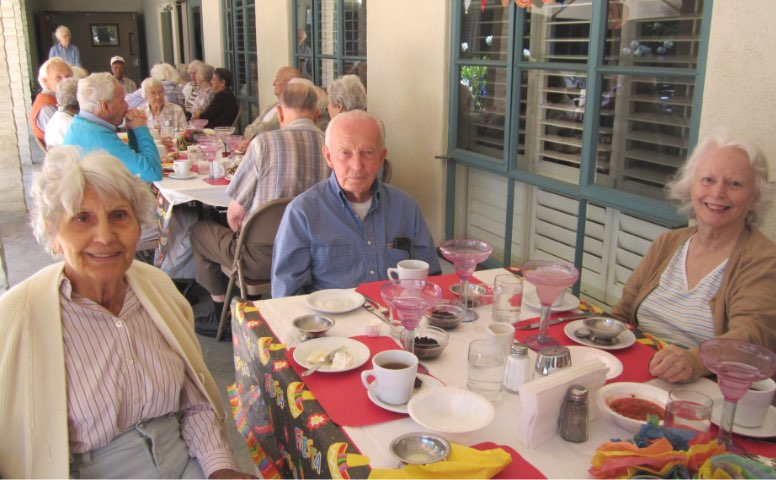 Elderly residents at Wood Glen Hall having lunch on the patio