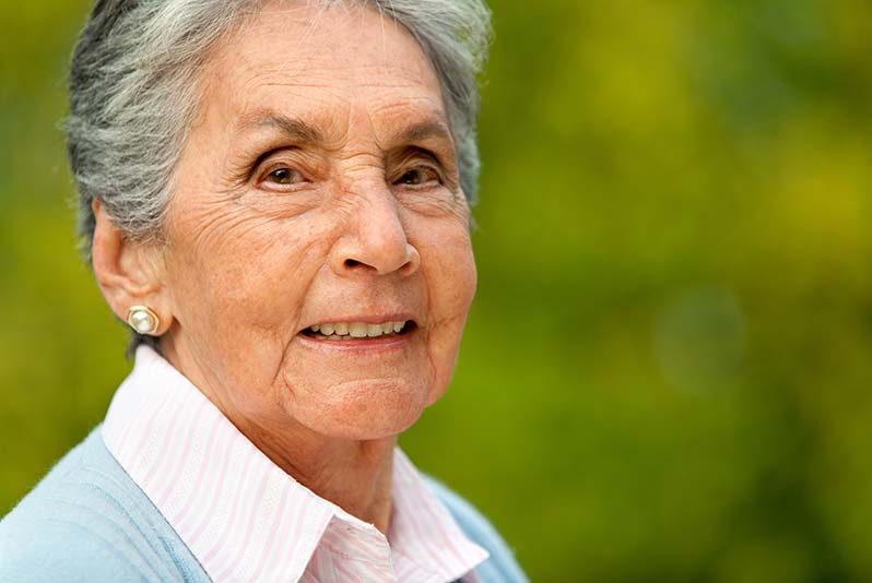 A well-dressed elderly woman with gray hair